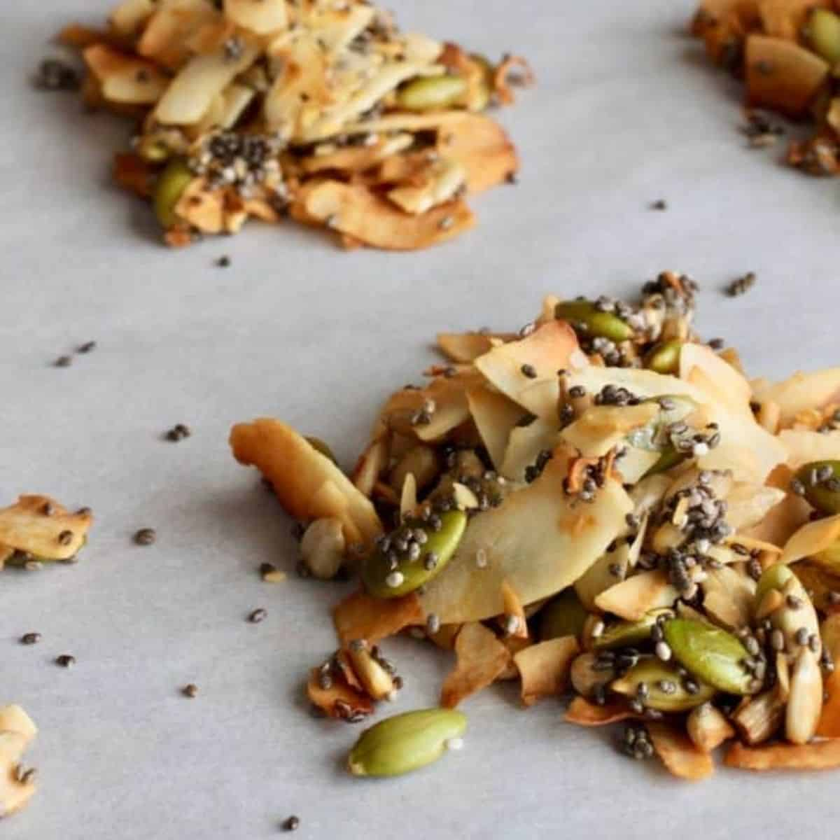 coconut clusters with pumpkin seeds, toasted coconut, on a baking pan