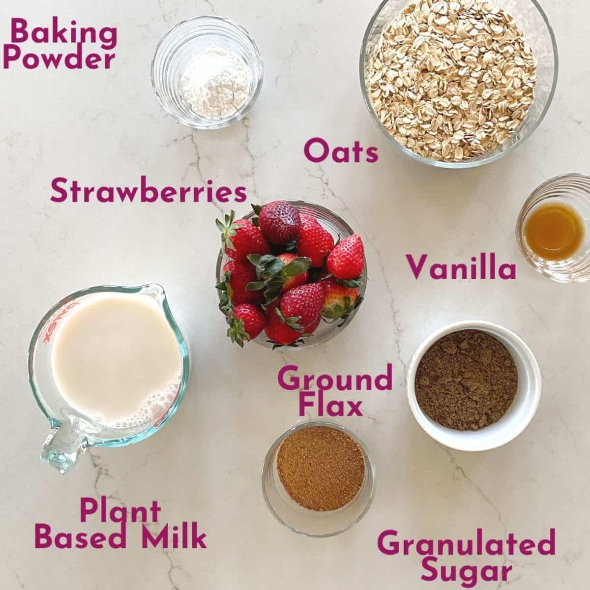Ingredients for strawberry baked oatmeal- strawberries, oats, milk, ground flax, baking powder, sugar, vanilla