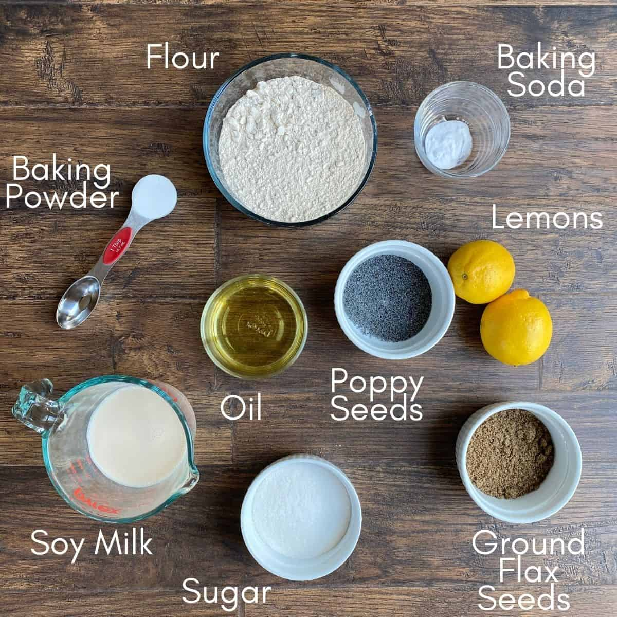 Ingredients for muffins: Flour, baking powder, baking soda, oil, sugar, poppy seeds, lemons, flax seeds, soy milk