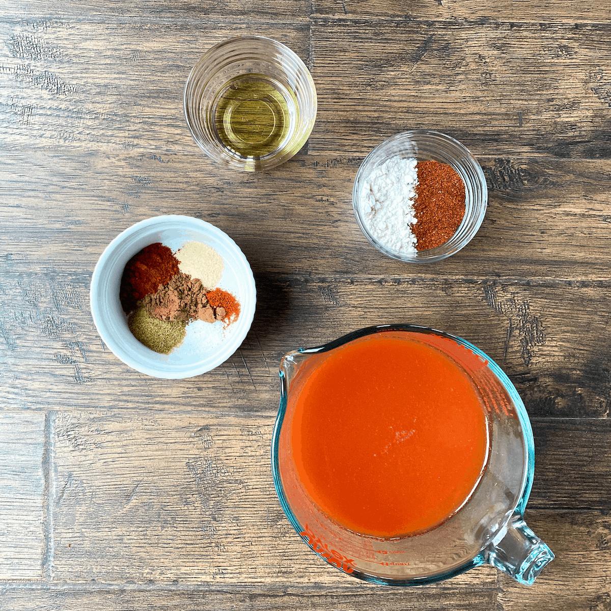 ingredients for enchilada sauce: oil, flour, chili powder, spice mix, cocoa powder, tomato paste, water, vinegar