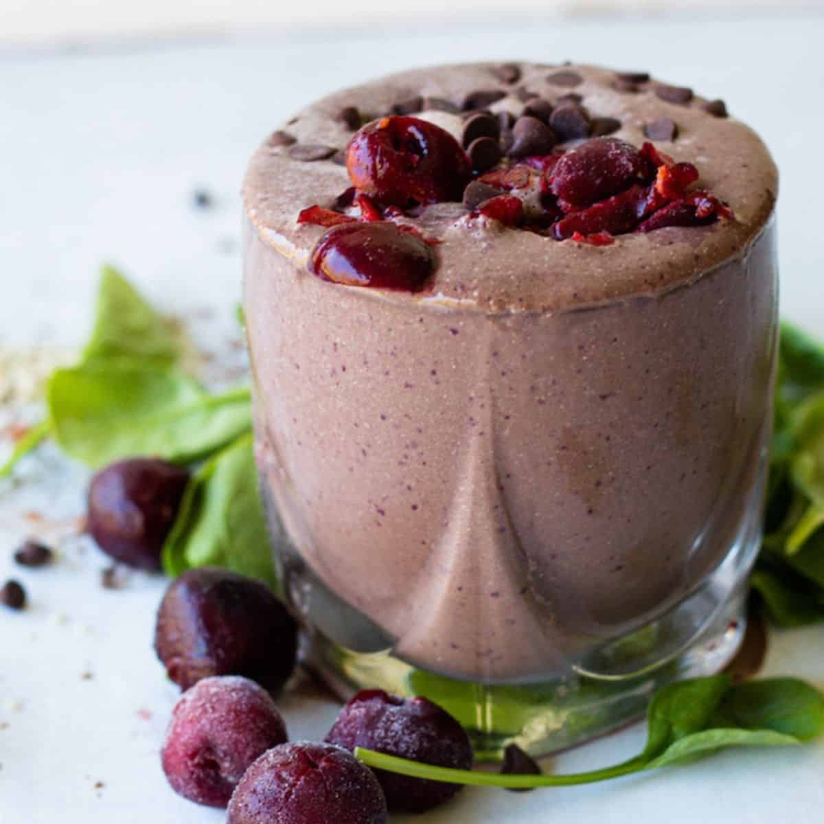 chocolate cherry smoothie garnished with cherries and chocolate chips.