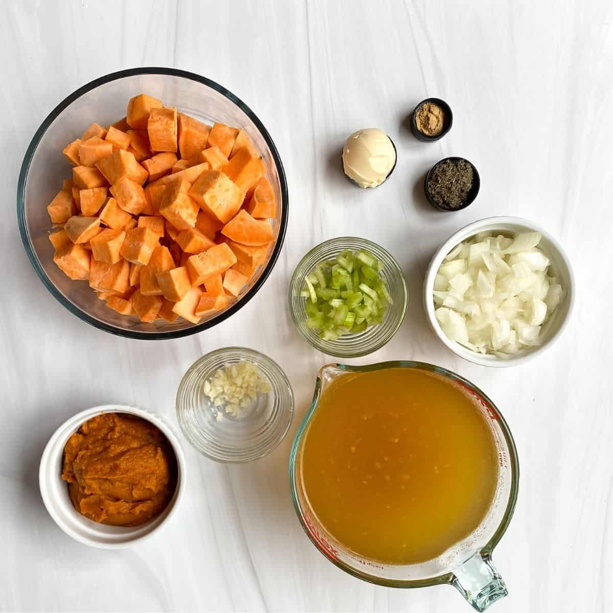 Ingredients for soup: sweet potatoes, pumpkin, celery, ponions, garlic, sage, butter, ginger, broth